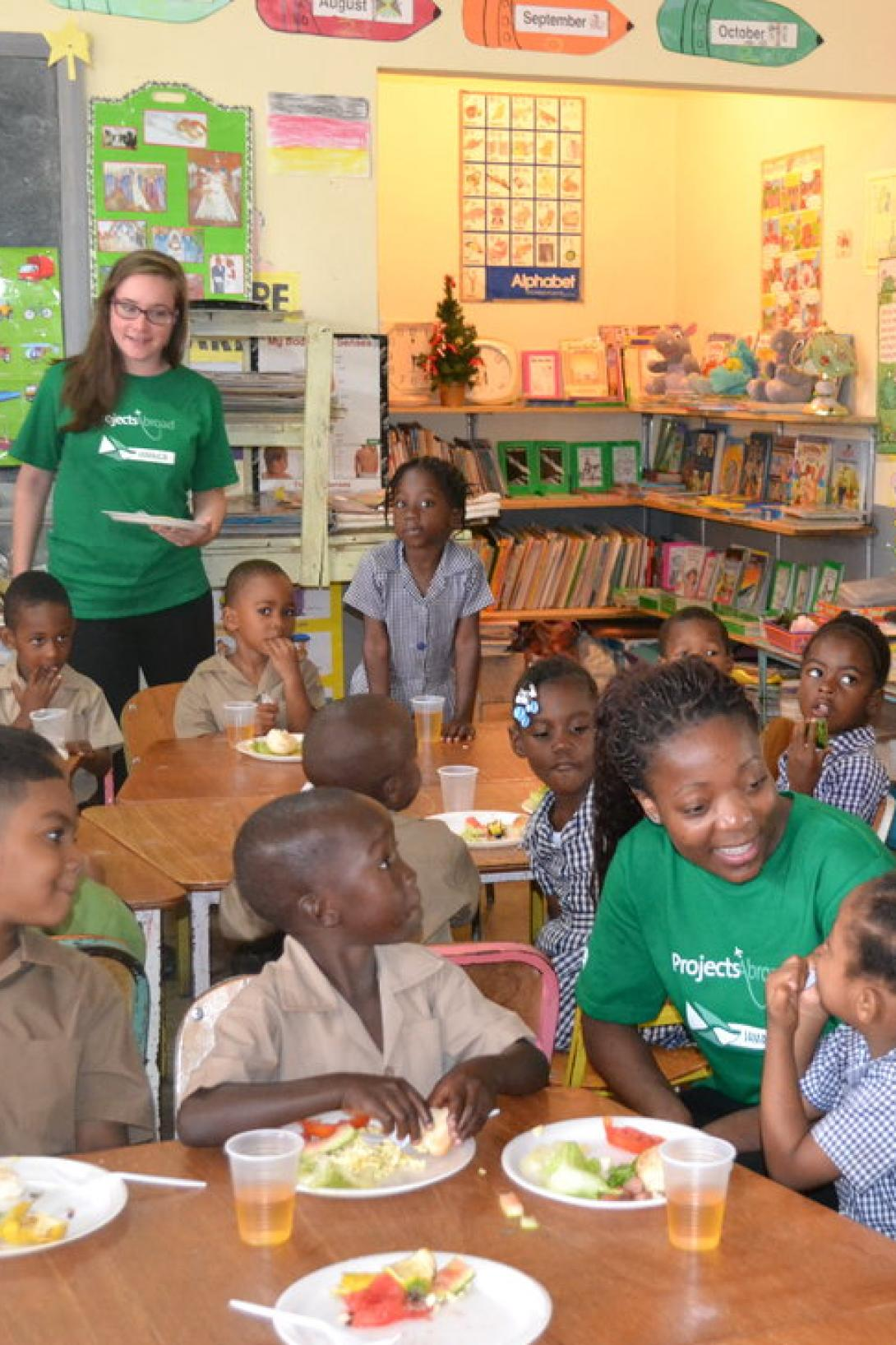 A group of Childcare volunteers in Jamaica prepare a healthy breakfast for children at a disadvantaged school.